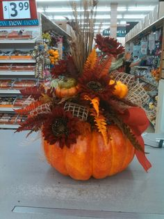 Talented Michael's Designers - Fall Red sunflowers and burlap on lg pumpkin @8811 Annapolis Md.