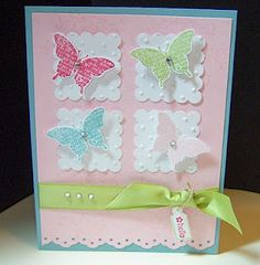 Would be cute wall hanging for baby girls room....solid back ground fabric, square doilies, free standing organza butterflies...add somea ribbon, pearls, glitz...