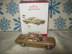 1965 Ford Mustang Hallmark Keepsake Ornament, 2014 - This ornament commemorating the 50th anniversary of the Mustang complements the Classic American Cars Series. I have this one.