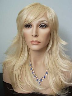 Large Fit, Choppy Layers, Skin Center Part, Nirvana Leelee, Long in Pale Blonde.