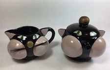I just bought a set like this at the Salvation Army thrift store. Only $4 for the pair!  Vintage Tilso Japan Redware Black Cat Cream & Sugar Set 11B