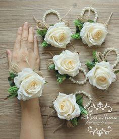 Silk Flower roses in ivory color with pinecone, decorated with twine. The wristlet is in imitation pearl cuff stretched bracelet. It is perfect for a woodlands or country/rustic wedding.  The size of corsage is about 8cm, and the bracelet is in 7 inches. Other sizes are available upon request. Made to order items. Processing day 5-7 working days.  The price is for one corsage. Products will be packed safely to ensure the products arrive in the best condition.  Shipping method: International…
