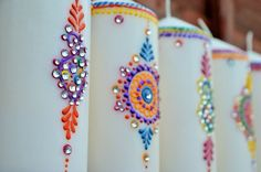 There are actually lots of things you can do with candles! We've tried to think outside the box, and have come up with this list of 25 different uses for candles Fancy Candles, Diy Candles, Glitter Candle Holders, Henna Candles, Mandala, Gem Crafts, Candle Art, Personalized Candles, Diwali Decorations