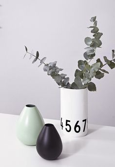 Decorative flower vases in ceramic and metal from Design Letters.