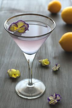Aviation cocktail 2 oz gin 1/2 oz maraschino liqueur 3/4 oz lemon juice 1/4 oz crème de violette edible violet for garnish