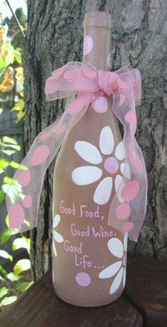 Painted Wine Bottle Art.. I want you to make these for me in different colors. It would be cool decoration in the spring.