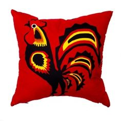 Red decorative pillow with cock