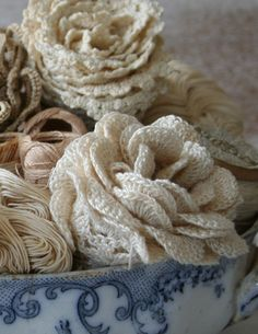 lengths of vintage lace rolled up into roses via ramblingrose.typepad.com