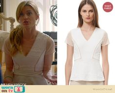 Paige's white textured peplum top with mesh sleeves on Royal Pains.  Outfit Details: http://wornontv.net/35628/ #RoyalPains