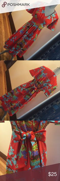 """👗Vintage kimono dress👗 Difficult to find. Vintage kimono dress. Pre-worn in very good condition. Light stain on the front, some loose stitch at the pit which is not seen when worn ( see photos). Tighten at the waist with its attached sash. Full back hidden zipper. V-neck. Butterfly sleeves and such a vibrant red orange color. Be the stand out for weekend brunch or can be worn as a costume. Measures flat: 17"""" at waist untied, pit to pit 18"""", top of back neck to bottom hem 40"""". Offers…"""