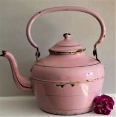 This is a beautiful Vintage Rare Pink with Gold Banding French Enamel Large Tea Pot in good vintage condition with usual age related marks. Size:Height (with handle) 11, width 11, depth 8 inches with a label. This is an amazing collectible and for someone who truly appreciates these rare enamel treasures and doesnt mind a bit of time worn imperfection. Please observe the photos to see all of the details and flaws. I have priced it accordingly. If you are a collector or lover of Vintage Tea…
