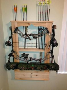 Custom Bow Rack I made. Constructed in Red Cedar with adjustable pegs to accommodate any size bow. And has locking bottom door.
