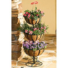 Add bursting color to your garden with a three-tier jardinierePlant stand comes with 12-inch, 14-inch and 16-inch basketsJardiniere includes natural fiber liners you can fill with vibrant flowers to accent your garden or patio