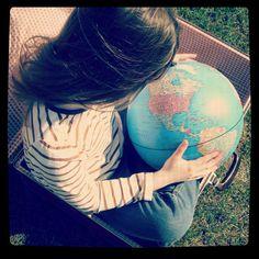 Girl and globe photograph