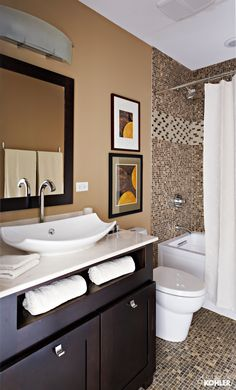 Oblo sink faucet Leaf Vessels sink Saile toilet Archer bath Oblo bath and shower faucet Chicago Remodel The dark and light contrast of the guest bedroom carries over to the bath, with white fixtures set against dark wood cabinetry.