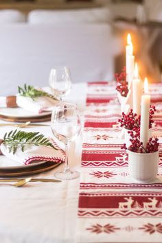 A Scandinavian-inspired Christmas tablescape with a simple red & white color scheme. White mugs, taper candles and red berries arranged along a runner. Norway Christmas, Norwegian Christmas, Scandinavian Christmas, All Things Christmas, White Christmas, Christmas Time, Woodland Christmas, Victorian Christmas, Vintage Christmas