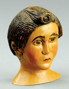 """FOLK ART CARVED FEMALE BUST  Well detailed carving, painted in flesh tone with brown hair, very early example. 4 3/4"""" h."""