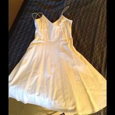 Michael Kors white eyelet spaghetti strap dress For sale is a gently worn Michael kors dress in size 12 eyelet material. It has the v neckline with side zipper which goes from under the arm to about the hip. It straight across in the back. The skirt is s full circle skirt . Michael Kors Dresses Midi