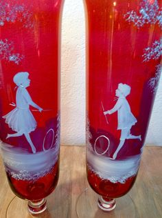 Vintage Mary Gregory style hand painted victorian children at play white enamel on flash iridescent cranberry trumpet glass vases