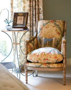 """The Beauty Is In The Details~~This floral toile feels right at home on a classic bergère. """"You can buy fabulous antiques, but without the magic of the right fabrics to complement them, you've compromised their impact,"""" Faudree advises. A rustic but shapely end table adds utility to this modest space."""