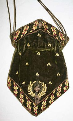 Early 19th century reticule, in silk, metal and glass. French. Length 10 and 1/4 inches. Appears to be silk ribbonwork, with rosy glass beads, and silver purl flowers and backgrounding to the wreath motif. This is the reticule I'd plan to make, but in lilac. Note also that the silk tassels are very fine and may feature beaded ends: hard to tell.