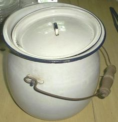 enamelware | This is a vintage enamelware chamber pot. It has a wire bail handle ...