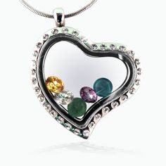 Sparkling heart locket necklace with family birthstones inside.