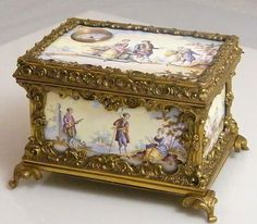 ANTIQUE MID 19TH CENTURY GILDED ORMOLU VIENNESE ENAMEL MUSICAL CASKET SET WITH A WATCH MOVEMENTEACH ENAMEL PANEL DEPICTING ROMANTIC SCENES.
