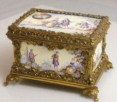 ANTIQUE MID 19TH CENTURY GILDED ORMOLU VIENNESE ENAMEL MUSICAL CASKET SET WITH A WATCH MOVEMENTEACH ENAMEL PANEL DEPICTING ROMANTIC SCENES.
