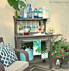 Turn a potting bench into an outdoor bar/beverage station.  Bench from World Market.
