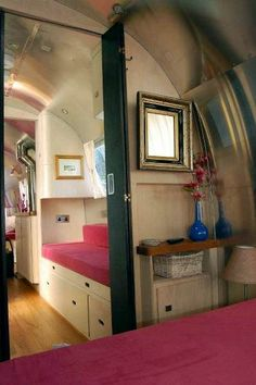 I would just LOVE to travel everywhere in this, I think the pink speaks to me!!!!! Airstream Caravan after refitting
