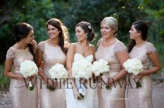 Kimberley styled the reception with amazing White Columbian Roses to match the bridal bouquets, and delicious salted caramel macaroons as wedding favours. Bridesmaids stunned wedding guests in our Sequin Gatsby bridesmaid dresses. The stunning backless full length sparkly gowns in golden blush tones complimented Kimberley's bridal gown to the tee!