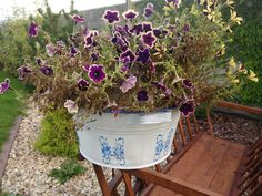 Tin flower pot with butterfly decor