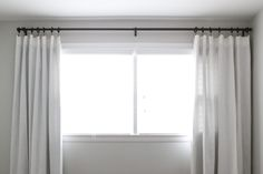 How to Hang Curtains to Make Your Windows Look Bigger - Easy DIY Guide | Zillow Digs