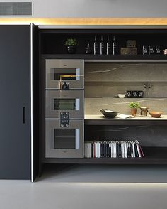 Modulnova Blade Unicore with Gaggenau appliances and Pietra Piasentina Stone
