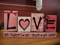 DIY V-day blocks  -scrapbook paper  -wood blocks  -letters  -modge poge. Maybe Kim can teach me?????
