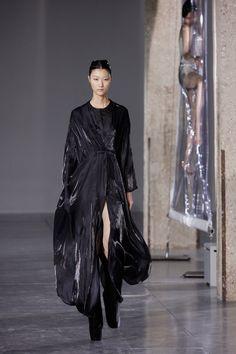 Iris van Herpen -  Biopiracy. Slick black dress-suit.