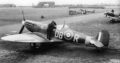 WAAF mechanics helping the pilot strap into a Spitfire Mk II of 411 (Canadian) Squadron, at Digby in Lincolnshire in 1941