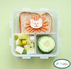 I am lion, hear me roar. This was a really fun bento for her afternoon nutrition break. She had half a turkey bologna sandwich with a cute little lion face on top. The lion face was made using a whole wheat tortilla, food safe markers and matchstick carrots. She also had a container of sliced pears with a lion pick and a container of crinkle cut cucumbers.