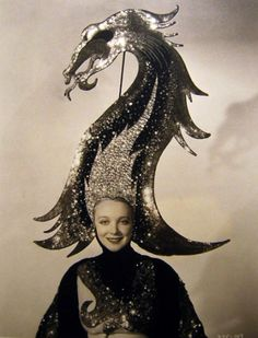 Virginia Bruce  c. 1930s  - Might be the time in my life to buy a humongous sparkly head piece?