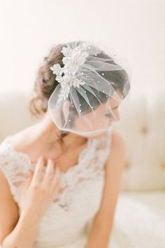 This crystal lace birdcage veil is made of a gorgeous crystal floral lace that is sewn to a handmade tulle birdcage veil, and then finished with many scattered crystals throughout. It measures approxi