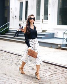 7 chic summer outfit ideas to copy from the best fashion blogger Instagrams of the week: Kat Tanita wears a ladylike mini skirt and a cut-out shoulder top