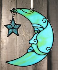 A x free-form crescent moon suncatcher with attached dangling star. The moon is done in a glass mix combining yellow, green, and blue an. Stained Glass Ornaments, Stained Glass Suncatchers, Stained Glass Lamps, Stained Glass Panels, Stained Glass Projects, Leaded Glass, Mosaic Glass, Stained Glass Patterns Free, Stained Glass Designs