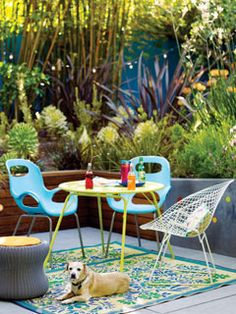 Simple, modern furniture in bright colors makes a small corner of a patio an intimate site for dinner or just a great spot to relax. An area rug makes the space feel like a whole new room. myhomeideas.com
