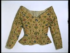 the late Elizabeth/early Jacobean era, from about 1600-1625, that I have always found particularly interesting.    One staple garment of English dress in this era was a linen jacket distinctly embroidered with a scrolling floral pattern. Several of these jackets have survived in private collections and museums, offering an incredibly rare opportunity to see and study actual 17th century garments.    Above, an extant jacket of the period currently in the Victoria and Albert Museum in London.