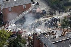 Emergency service personnel work at the scene of a house explosion, Tuesday, Sept. 27, 2016, in the Bronx borough of New York. (AP Photo/Mary Altaffer)