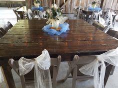 light blue material with wood slice mason jar flower arrangement on farm wood table