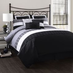 A black, white and grey colorblock pattern gives the Mia comforter set by Lush Decor a classy yet contemporary feel. Designed with a trendy pleated ruffle motif, this set comes with everything you need to transform your bedroom decor.