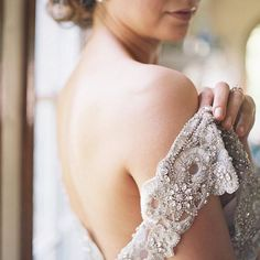 We love this intimate image by @courtneemurphyphotos and @aceandwhim of the intricate sleeves on our Tallulah dress - so pretty! #annacampbell #wedding #pretty #lace