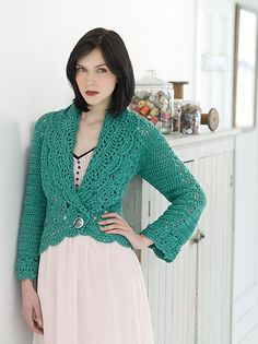 Pretty crochet lace patterns add an elegant touch to this comfy cardigan. Created with basic heavy worsted weight yarn, you'll enjoy wearing it over a dress or more casual attire.
